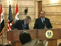 bush ducking a flying shoe in Iraq