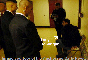 joe-miller-thugs-handcuff-tony-hopfinger