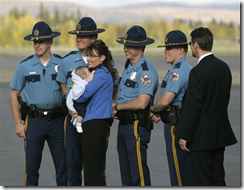 Sarah Palin posing with troopers in Anchorage on Sept 11, 2008